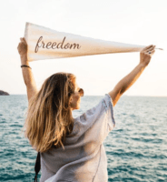 Woman holding banner with word freedom. Aign with values to lighten mental load.