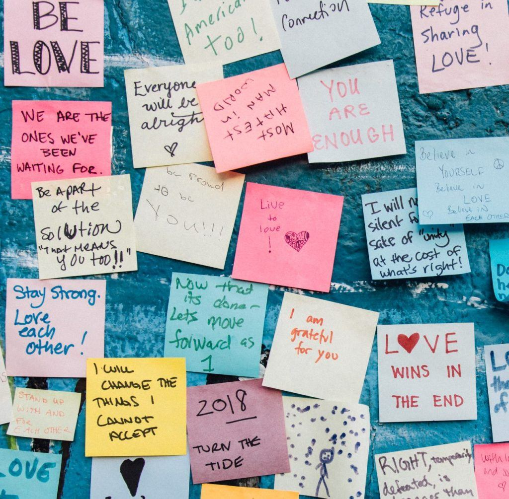 Wall of sticky notes about love, courage, being enough